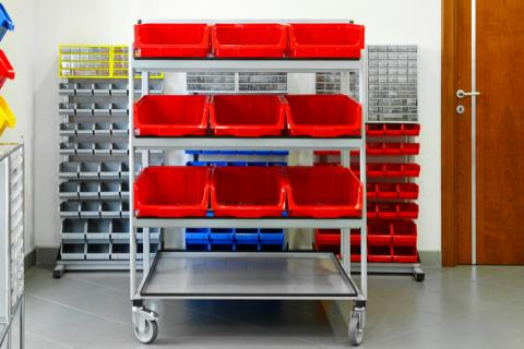 Red bins on a rolling shelving cart